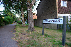 © Licensed to London News Pictures. 16/09/2021. Reading, UK. A street sign and a path that leads to a property on Hadrian Walk East in Whitley, Reading following the discovery of a body in Erith, London on Wednesday 15/09/2021. A murder investigation was launched by Thames Valley Police's Major Crime Unit in connecting with a missing person investigation that was launched on 24/08/2021 following a report that a person had gone missing from the Reading area. Photo credit: Peter Manning/LNP