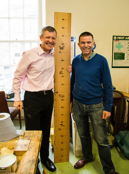 Pictured: Willie Rennie, was shown round the woodworking room by Senior manager Tommy Steel. Mr Rennie was keen to see if he measured up to the job as First Minister<br /> <br /> Scottish Liberal Democrat leader Willie Rennie met staff and customers at the Grassmarket café, part of the Grassmarket Community Project, as he visited the Edinburgh social enterprise today as part of his election campaign. He took the opportunity to set out Lib Dem student support plans ahead of an NUS election hustings in Glasgow. <br /> Ger Harley | EEm 11 April 2016