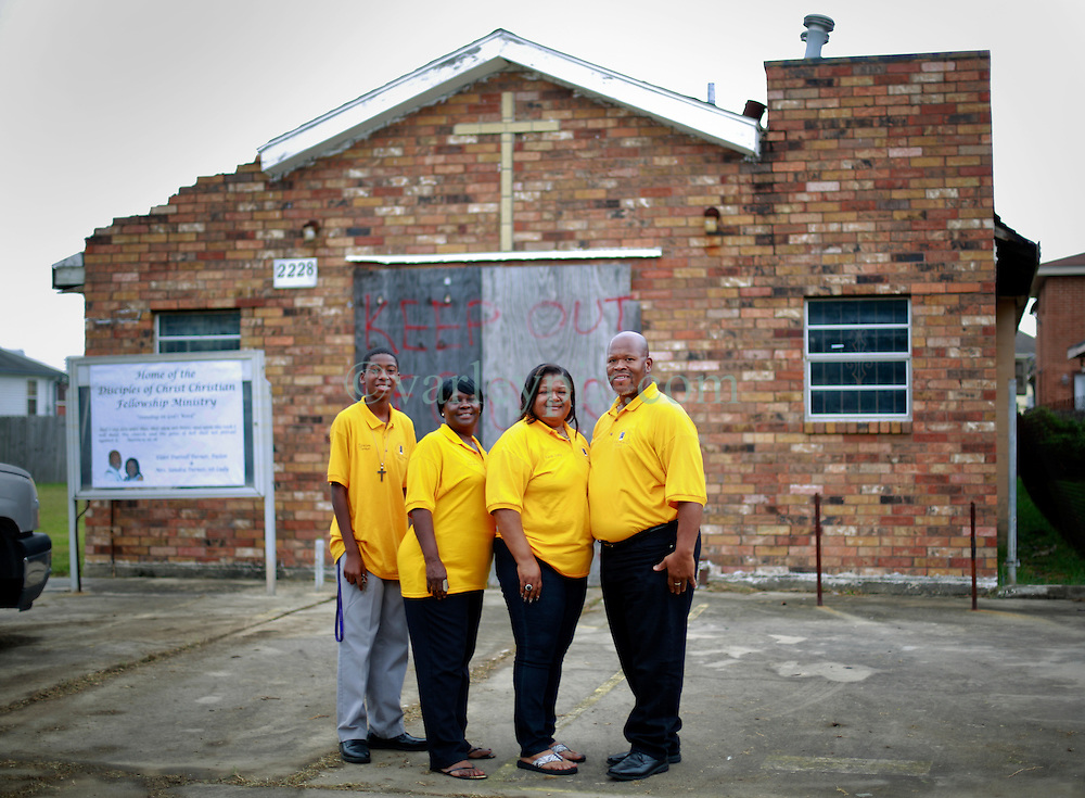 27 August 2014. Lower 9th Ward, New Orleans, Louisiana.<br /> Hurricane Katrina 9 years later. R/L; Pastor Darrell Turner, Sandra Turner, Yvonne Sylvester and Emmanuel Turner. Disciples of Christ Christian Fellowship led by Pastor Turner arrive at a derelict church they have just purchased. Bringing hope to the neighborhood still struggling to recover from hurricane Katrina, Pastor Turner hopes to have the renovations completed within a year, ready for the 10th anniversary of the storm. <br /> Photo; Charlie Varley/varleypix.com