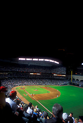 Stock photo of fans watching a night Astros game at Minute Maid Park with the roof open