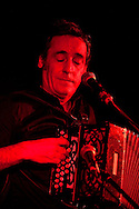 Fest Noz in Rennes, Brittany, France (21 November 2014). Traditional Breton musicians Etienne Grandjean (accordion, pictured) and Soig Siberil (guitar) perform a concert at Ty Anna Tavern, part of the Yaouank Festival. The evening marked 20 years that the two have been performing together. Fest Noz is a traditional Breton festival with traditional music, dance and song, and is inscribed on the UNESCO list of Intangible Cultural Heritage. © Rudolf Abraham.