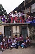 TODOS  SANTOS, Guatemala. Groups of Mayan people watch celebrations. Western Highlands, Huehuetenango, Todos Santos. Mayan traditional festival. Todos Santos Horse Race, the 'Skach Koyl' on All Saints Day 1st November; the 'Day of the dead' November 2nd. Mayan dances about Spanish 'Conquistadores' and Mayan Spirits, accompanied by marimbas take place October 31st.