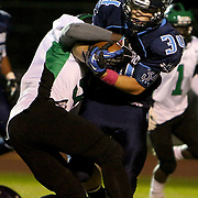 Hoggard's Trevor Brown rushes against West Brunswick's Zaire Hankins Monday night at Hoggard High School. (Jason A. Frizzelle)
