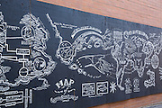 Blackboard map for Tom's shoes painted on an alley wall in Wicker Park August 2, 2015 in Chicago, Illinois, USA.