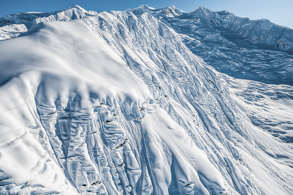 """A snowboarders paradise. This face in Alaska has been dubbed """"So Far Gone"""" due to its extreme pillows of snow and fresh powder."""