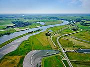 """Nederland, Overijssel, Gemeente Kampen; 21–06-2020; zicht op de IJssel ter hoogte van Wilsum met de Onderdijkse Waard. Voorgrond de Scheeresluis, recreatieschutsluis en ingang voor de pleziervaart van het Reevediep. Midden rechts het inlaatwerk van het nieuw aangelegde Reevediep,  Het Lange End.<br /> Het Reevediep is aangelegd in het kader van het project Ruimte voor de Rivier om bij hoogwater water af te voeren voordat dit het nabij gelegen Kampen bereikt, direct naar het IJsselmeer, de 'bypass Kampen'. Het Reevediepgebied is ook een natuurgebied en vormt een ecologische verbindingszone tussen rivier de IJssel en Drontermeer.<br /> View of river IJssel near Wilsum with the Onderdijkse Waard. Foreground the Scheeresluis, recreational lock and entrance for the pleasure craft of the Reevediep. In the middle the inlet of the newly constructed Reevediep, The Long End.<br /> The Reevediep has been constructed as part of the Room for the River project, and functions to discharge high waters before reaching the nearby Kampen, directly to the IJsselmeer, the """"bypass Kampen"""". The Reevediep area is also a nature reserve and forms an ecological connecting zone between the river IJssel and Drontermeer.<br /> <br /> luchtfoto (toeslag op standard tarieven);<br /> aerial photo (additional fee required)<br /> copyright © 2020 foto/photo Siebe Swart"""