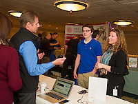 Michele and Tom Sawyer of Lakes Region Computer speak with Belmont High School student Eric Osgood and Amy Burke BHS School to Career Coordinator during the Lakes Region Job Fair on Wednesday afternoon at the Margate Resort.  (Karen Bobotas/for the Laconia Daily Sun)