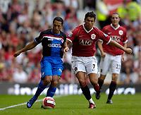 Photo: Jed Wee.<br />Manchester United v Seville. Pre Season Friendly. 12/08/2006.<br /><br />Seville's Correia Adriano (L) tries to take on Manchester United's Cristiano Ronaldo.