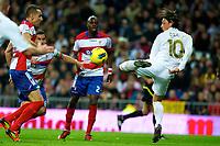 20120107: MADRID, SPAIN - BBVA League: Football macht between Real Madrid C.F vs Granada in Santiago Bernabeu, Madrid, Spain.<br /> In photo: Ozil(L) figth the ball.<br /> PHOTO: CITYFILES