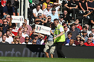 A Fulham fan invades the field of play and is taken away by a steward. EFL Skybet football league championship match, Fulham  v Norwich city at Craven Cottage in London on Saturday 5th August 2017.<br /> pic by Steffan Bowen, Andrew Orchard sports photography.