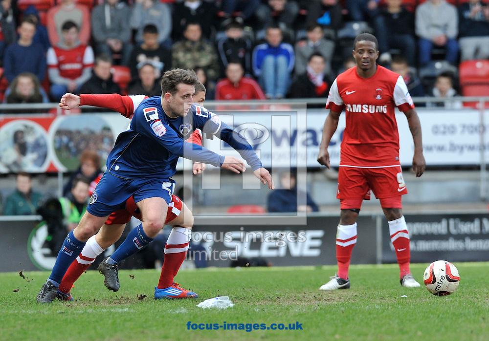 Picture by Alan Stanford/Focus Images Ltd +44 7915 056117.27/04/2013.Kevin Lisbie (right) of Leyton Orient watches as Jose Baxter of Oldham Athletic come away with the ball during the npower League 1 match at the Matchroom Stadium, London.. .