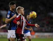Raphael Rossi Branco of Swindon Town tussles with Mark Duffy of Sheffield United during the English Football League One match at Bramall Lane, Sheffield. Picture date: December 10th, 2016. Pic Jamie Tyerman/Sportimage