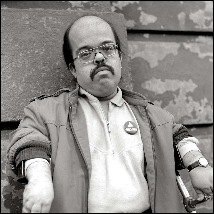 """Harry Weider, a self-described """"disabled, gay, Jewish, leftist, middle aged dwarf"""", was an avid activist for gay rights, disabled rights and neighborhood rights. <br /> <br /> Photographed for Outweek Magazine in October of 1989."""