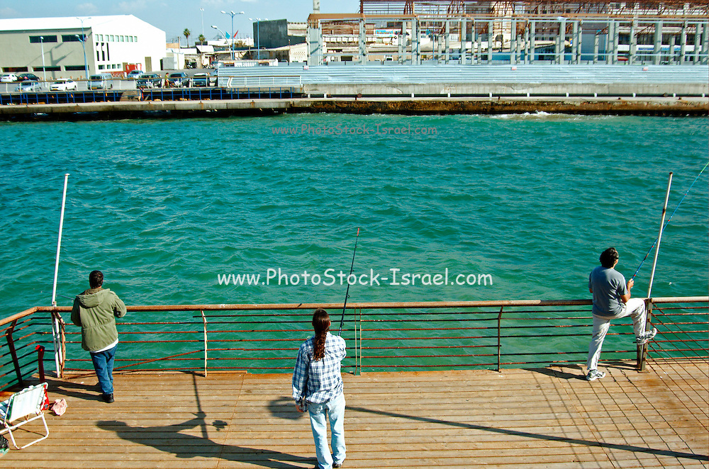 Israel, Tel Aviv, Fishermen at the old Tel Aviv port