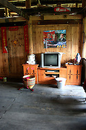 Interior of an ethnic house with communist leader poster. Area of Ping'an, Guangxi, China, Asia