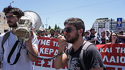 June 14, 2018 - Athens, Greece - A protester shouts slogans during the rally..A protest against multi bill prerequisites for the completion of the 4th evaluation voted by the government in the Parliament. (Credit Image: © Ioannis Alexopoulos/SOPA Images via ZUMA Wire)