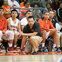 Gallup Bengals head coach Josh Dunlap watches from the bench against Sandia Prep Friday Jan. 3 at the Gallup Invitational boys basketball tournament at Gallup High School. Gallup beat Sandia Prep 61-60.