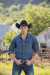 handsome cowboy on a ranch