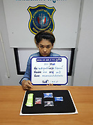 """female drug dealer caught with drugs in bra<br /> <br /> Police arrested three Thai women after they were found to be in possession of a various amounts of methamphetamine pills (ya bah).<br /> <br /> Maj Ritthichai Chumchuay together with a team of officers from Phuket Provincial Police Station first apprehended 24-year-old Paramee (Pa) Songsan from Trang, at 9pm on Thursday at the Phuket Bus Terminal 2 on Thepkassatri Rd in Rassada.<br /> <br /> Paramee arrived on the island on a bus travelling from Satun when she was found to be in possession of 1,000 ya bah pills. Paramee confessed that all the pills belonged to her and she told police that she brought them from a man named only as Mr Den in Trang.<br /> <br /> She travelled to Phuket in the hope of selling the pills here.<br /> <br /> The arrest of Pareemee then led police to arrest two other women.<br /> <br /> At 11pm on Thursday police arrested 24-years-old Chutharat """"Am"""" Raksuwan from Trang at a rented room in Chalong when she was found to be in possession of 612 of ya bah pills.<br /> <br /> Chutharat told police that she received the pills from her friend, Paramee, and sold them on her behalf.<br /> <br /> Then at 11pm yesterday police arrested 24-years-old Aungkana 'Kan' Supphakeeratirot also from Trang at the Phuket Bus terminal 2 when she was found in possession of 1,000 ya bah pills.<br /> <br /> The arrest of Aungkana came after Paramee helped police order more drugs from Mr Den.<br /> <br /> Mr Den told Paramee that the drugs would be delivered to her by her friend Aungkana who would travel to Phuket by bus.<br /> <br /> The three women confessed to all charge made against them.<br /> ©Phuket News/Exclusivepix Media"""