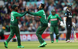 Bangladesh's Shakib Al Hasan (centre) celebrates taking the wicket of New Zealand's Colin Munro during the ICC Cricket World Cup group stage match at The Oval, London.