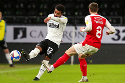 Nathan Byrne of Derby County hoofs the ball away from Ben Wiles of Rotherham United - Mandatory by-line: Ryan Crockett/JMP - 16/01/2021 - FOOTBALL - Pride Park Stadium - Derby, England - Derby County v Rotherham United - Sky Bet Championship