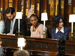 (Left to right) Alexis Ohanian, Serena Williams and Abigail Leigh Spencer take their seats in St George's Chapel at Windsor Castle for the wedding of Prince Harry to Meghan Markle.