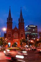 Traffic whizzes by Saigon Notre Dame Basilica in a blur.