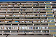 A vivid blue curtain is stretched over a window of an otherwise grey block of flats on the Thurlow Street estate, on 28th November 2016, in the south London borough of Southwark, England.