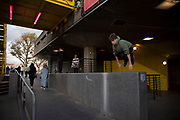 Parkour practitioners underneath the yellow gantry on the Southbank, London, United Kingdom. The South Bank is a significant arts and entertainment district, and home to an endless list of activities for Londoners, visitors and tourists alike. (photo by Mike Kemp/In Pictures via Getty Images)