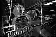 15/06/1963.06/15/1963.15 June 1963.Finnish visitors tour Bord na Mona works..the 48 members of the Finnish Peat Society, who arrived in dublin on Friday 14/06/1963, toured Bord na Mona works in Offaly and Kildare on Saturday..Mr. V. Puustjarvi, University of Helsinki (right) and Mr. P. McEvilly, Manager Croghan Briquette Factory, watching the working of a briquette baling at Croghan briquette factory near Mount Lucas, Co. Offaly. .