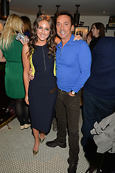 NATASHA CORRETT and BRUNO TONIOLI at a party to celebrate the publication of Honestly Healthy Cleanse by Natasha Corrett held at Tredwell's Restaurant, 4a Upper St.Martin's Lane, London on 14th January 2015.