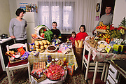 The Dudo family in the kitchen/dining room of their home in Sarajevo, Bosnia and Herzegovina, with one week's worth of food. Standing between Ensada Dudo, 32, and Rasim Dudo, 36, are their children (left to right): Ibrahim, 8, Emina, 3, and Amila, 6. From the book Hungry Planet: What the World Eats (Model Released)