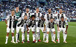 Juventus players pose for a photograph before kick-off