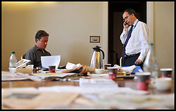 The Prime Minister David Cameron goes through his speech with his Chief of Staff Ed Llewellyn on the morning he has to deliver it to the Conservative Party Conference in Manchester, Wednesday October 5, 2011. Photo By Andrew Parsons / i-Images.