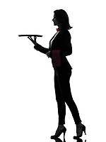 one  woman waiter butler holding empty tray in silhouette on white background