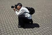 senior man taking photographs Japan