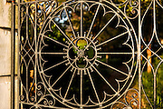 Decorative ironwork gate entry to a private home on the Battery in historic Charleston, SC.