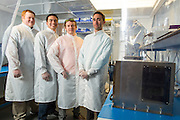 The Made In Space team poses for a portrait at NASA Ames Research Park, Building 20, at Moffett Field in Mountain View, California, on May 1, 2014. (Stan Olszewski/SOSKIphoto for Content Magazine)