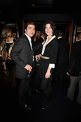 LADY LAURA CATHCART and AXEL DE MEGILLE at the Tatler Little Black Book Party held at Tramp, 40 Jermyn Street, London on 3rd November 2010.