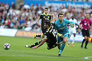Lukasz Fabianski, the Swansea goalkeeper collides with Diego Costa of Chelsea just outside penalty area but the referee Andre Marriner waves play on. .  Premier league match, Swansea city v Chelsea at the Liberty Stadium in Swansea, South Wales on Sunday 11th Sept 2016.<br /> pic by  Andrew Orchard, Andrew Orchard sports photography.
