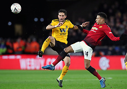 Wolverhampton Wanderers' Joao Moutinho (left) and Manchester United's Jesse Lingard battle for the ball during the FA Cup quarter final match at Molineux, Wolverhampton.