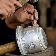 Closeup detail of artisan carving silver (Luang Prabang (Louangphrabang), Laos - Nov. 2008) (Image ID: 081124-1002282a)