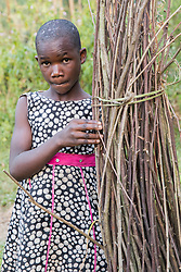Girl With Thatching Material