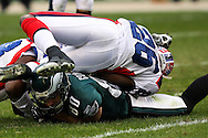 PHILADELPHIA - DECEMBER 30: Kevin Curtis #80 of the Philadelphia Eagles is brought down by Ashton Youboty #26 of the Bills during the game against the Buffalo Bills on December 30, 2007 at Lincoln Financial Field in Philadelphia, Pennsylvania. The Eagles won 17-9.
