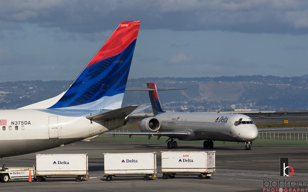 A Delta Airlines airplane taxis past another Delta aircraft at Terminal 1 at San Francisco International Airport on Saturday, Dec. 1, 2007. (Photo by Kevin Bartram)