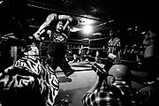 May 14, 2009-Denver, Colorado, USA-Micro Wrestling Federation wrestler Justice walks around the ring with Jmazing above his head before throwing him to the ring floor during the performance at 3 Kings Tavern. (Credit Image: Bret Hartman/Zuma Press)