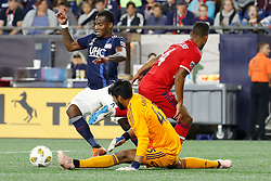 September 22, 2018 - Foxborough, MA, U.S. - FOXBOROUGH, MA - SEPTEMBER 22: New England Revolution forward Cristian Penilla (70) beats Chicago Fire defender Johan Kappelhof (4) and Chicago Fire goalkeeper Richard Sanchez (33) to even the match during a match between the New England Revolution and the Chicago Fire on September 22, 2018, at Gillette Stadium in Foxborough, Massachusetts. The teams played to a 2-2 draw. (Photo by Fred Kfoury III/Icon Sportswire) (Credit Image: © Fred Kfoury Iii/Icon SMI via ZUMA Press)
