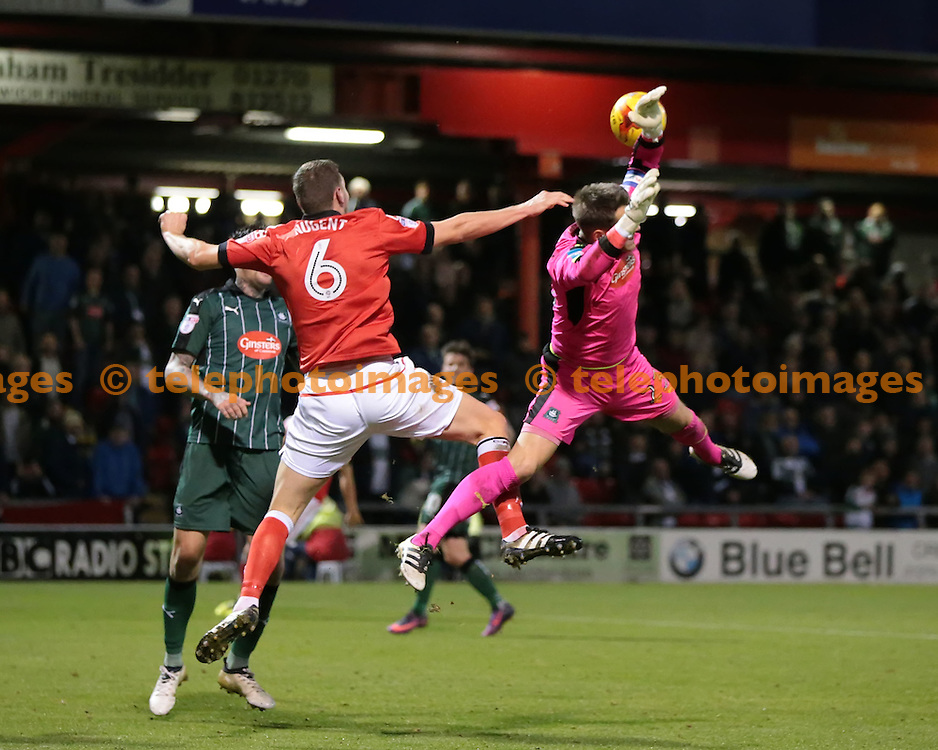Plymouth Albion goalkeeper Luke McCormick (23) is fouled by Crewe Alexandra defender Ben Nugent (6) during the Sky Bet League 2 match between Crewe Alexandra and Plymouth Argyle at Alexandra Stadium in Crewe. November 12, 2016.<br /> Nigel Pitts-Drake / Telephoto Images<br /> +44 7967 642437