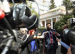 ATHENS, March 13, 2018  Greek Deputy Sports Minister Yorgos Vassiliades speaks to the media in Athens March 12, 2018. Vassiliades announced that the Greek Super League has been suspended indefinitely after a football club owner entered the field with arms during a match Sunday evening in Thessaloniki City of north Greece. (Credit Image: © Marios Lolos/Xinhua via ZUMA Wire)