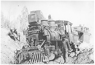 """RGS class 60 locomotive #15 on the ground south of Ridgway while on a caboose hop with #0400.<br /> RGS  s. of Ridgway, CO  3/1920<br /> In book """"RGS Story, The Vol. XII: Locomotives and Rolling Stock"""" page 35"""